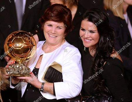Maria Dolores Dos Santos Aveiro (l) Mother of Real Madrid's Portuguese Striker Cristiano Ronaldo (not Pictured) and Ronaldo's Sister Katia Aveiro (r) Pose with the Ballon D'or Trophy Which Ronaldo Received As the Fifa Men's World Player of the Year 2013 During the Fifa Ballon D'or 2013 Gala at the Kongresshaus in Zurich Switzerland 13 January 2014 Switzerland Schweiz Suisse Zurich