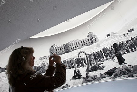 A Photo Journalist Takes a Picture of a Woman in Front of a Collage by Polish Artist Goshka Macuga Showing the Ruins of a Palace in Kabul in the Fridericianum in Kassel Germany 06 June 2012 the Exhibition Opens to the Public on 09 June and Runs Until 16 September Germany Kassel
