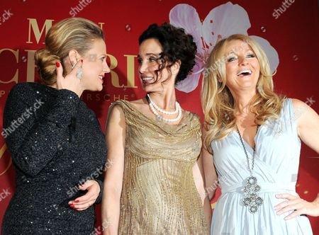 (l-r) German Television Host Barbara Schoneberger Us Actress Andie Macdowell and German Television Host Frauke Ludowig Pose at a Party on the Occasion of Barbara Day in Munich Germany 03 December 2011 the Aim of the Event is to Raise Money For Charity Germany Munich