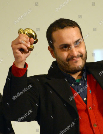 Stock Image of Danish-palestinian Director Mahdi Fleifel Gestures After Receiving the 28th Peace Film Award of the 63rd International Berlin Film Festival at Babylon Cinemas in Berlin Germany 17 February 2013 the Berlinale Runs From 07 to 17 February Germany Berlin