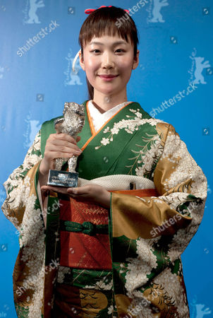 Japanese Actress Haru Kuroki Poses with the Silver Bear For Best Actress For Her Performance in 'Chiisai Ouchi' (the Little House) During a Photocall at the 64th Annual Berlin Filmáfestival in Berlin ágermany 15 February 2014 the Berlinale Festival Runs Until 16 February Germany Berlin