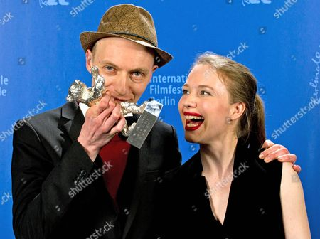 German Director Dietrich Brueggeman (l) and His Sister Scriptwriter Anna Brueggemann (r) Pose with the Silver Bear For Best Script For 'Kreuzweg' (stations of the Cross) During a Photocall at the 64th Annual Berlin Filmáfestival in Berlin ágermany 15 February 2014 the Berlinale Festival Runs Until 16 February Germany Berlin