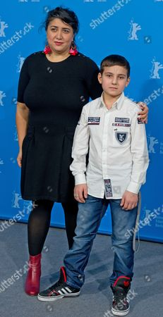 Austrian Film Maker Sudabeh Mortezai and Young Actor Ramasanáminkailov Pose During the Photocall For the Movie 'Macondo' at the 64tháberlin Film Festival in Berlin ágermany 14 February 2014 the Movie is Presented in the Official Competition of the Berlinale Which Runs From 06 to 16 February 2014 Germany Berlin