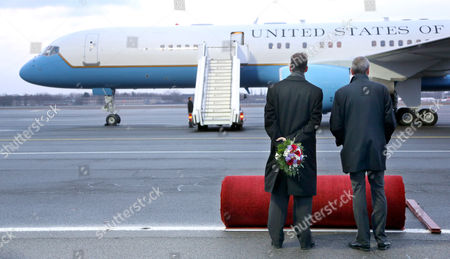 Ready to Roll the Us Ambassador to Germany Philip D Murphy (r) and an Associate Carrying a Floral Bouquet Wait For Us Vice President Biden and His Wife Jill to Exit the Plane at Tegel Airport in Berlin Germany 01 February 2013 During His Visit Biden Will Meet the German Chancellor Angela Merkel Germany Berlin