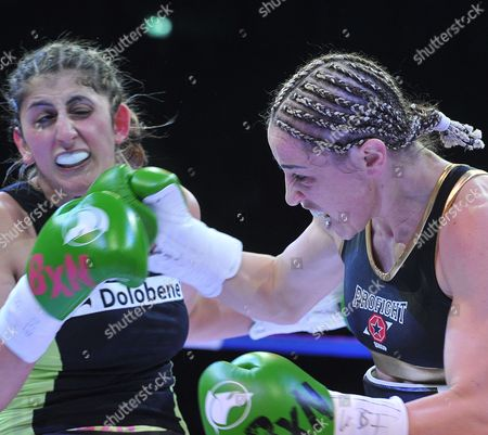 Stock Photo of Lebanese Born German Boxer Rola El-halabi (l) Fights Against Lucia Morelli (r) From Italy in a Lightweight Worldchampionship Fight in Neu Ulm Germany 12 January 2013 Germany Neu-ulm