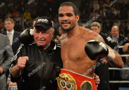 German Boxer Yoan Pablo Hernandez (r) and Coach Ulli Wegner Celebrate After the Ibf-wm Cruiserweight Fight Against Russian Alexander Alexeyev in the Brose Arena in Bamberg Germany 23 November 2013 Hernandez Won by K O in the Tenth Round Germany Bamberg