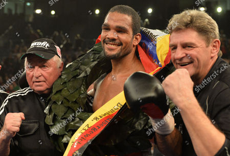 German Boxer Yoan Pablo Hernandez (c) Coach Ulli Wegner (l) and Georg Bramowski Celebrate After the Ibf-wm Cruiserweight Fight Against Russian Alexander Alexeyev in the Brose Arena in Bamberg Germany 23 November 2013 Hernandez Won by K O in the Tenth Round Germany Bamberg