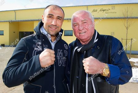 Wbo Super Middleweight World Champion Arthur Abraham (l) From Germany and Boxing Coach Ulli Wegner (r) Pose For Photographers in Front of the 'Ulli Wegner' Gymnasium at the Usedom Elementary School on Usedom Island Germany 14 March 2013 Abraham Has Been Preparing in Usedom to Defend His Title Against His Compatriot Robert Stieglitz on 23 March 2013 in Magdeburg Germany Usedom