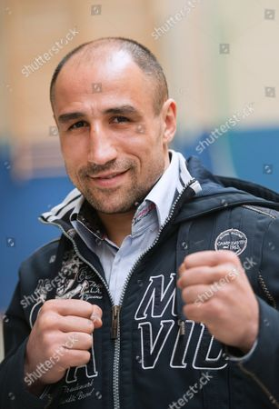 Wbo Super Middleweight World Champion Arthur Abraham From Germany Poses For Photographers in Front of the 'Ulli Wegner' Gymnasium at the Usedom Elementary School on Usedom Island Germany 14 March 2013 Abraham Has Been Preparing in Usedom to Defend His Title Against His Compatriot Robert Stieglitz on 23 March 2013 in Magdeburg Germany Usedom