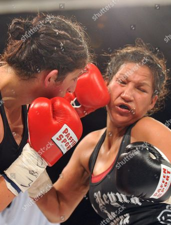 Rola El-halabi Professional German Boxer of Lebanese Origin (l) in Action Against Victoria Cisneros of the Usa During Their Wbf Title Fight in Ulm Germany 10 May 2014 Wbf Light Welterweight Champion Rola El Halabi Successfully Defended Her Title Germany Ulm