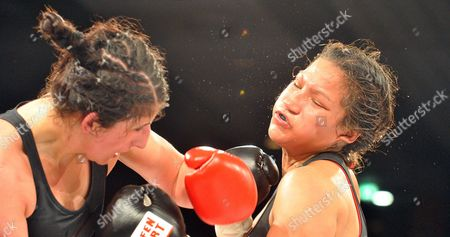 Stock Image of Rola El-halabi Professional German Boxer of Lebanese Origin (l) in Action Against Victoria Cisneros of the Usa During Their Wbf Title Fight in Ulm Germany 10 May 2014 Wbf Light Welterweight Champion Rola El Halabi Successfully Defended Her Title Germany Ulm