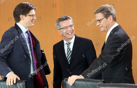 Secretary of State at the Ministry of the Interior Ole Schroeder (l-r) German Minister of Defence Thomas De Maiziere (cdu) and German Foreign Minister Guido Westerwelle (fdp) Talk Before the Weekly Cabinet Meeting at the Federal Chancellery in Berlin Germany 02 May 2012 the Cabinet Will Decide on Another Bundeswehr Deployment in the Kosovo Amongst Other Things Germany Berlin