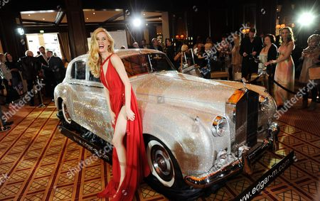 German Actress Wilma Elles Poses with a 1962 Rolls Royce Silver Cloud Which is Studded with Swarovski Crystals During a Charity Event at the Four Seasons Hotel in Munich Germany 17 July 2012 the Rolls Royce was Studded with About One Million Crystals Which Took Three Years to Complete the Car Will Be Auctioned Off to the Highest Bidder in the Coming Months to Benefit the Foundation 'Help in Motion' Germany Munich