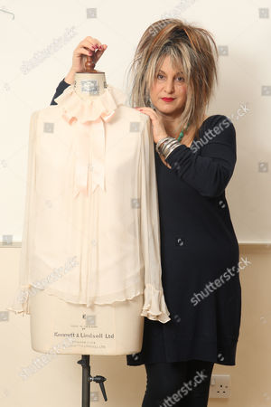 Elizabeth Emanuel with a blouse which Lady Diana Spencer wore during a photo shoot with Lord Snowdon to announce her engagement in Vogue magazine