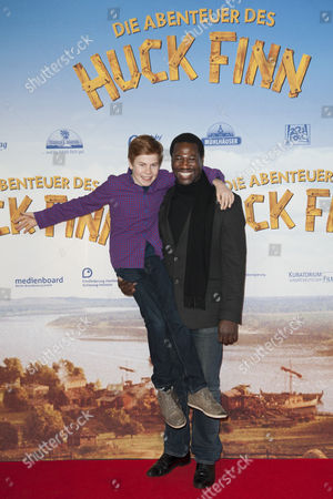 Burkina Faso-born French Film Actor Jacky Ido (r) and Actor Leon Seidel Pose For a Picture As They Arrive For the German Premiere of the Movie Film 'Adventures of Huck Finn' in Berlin Germany 16 December 2012 the Movie Will Be Released in German Theatres on 20 December 2012 Germany Berlin