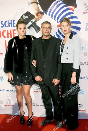 Actresses French Adele Exarchopoulos (l)ábelgian Mona Walravens and French Director Abdellatif Kechiche (c) Arrive For the Movie Premiere 'Blue is the Warmest Colour' by Director Kechiche at the Cinema Paris in Berlin Germany 08 December 2013 Germany Berlin
