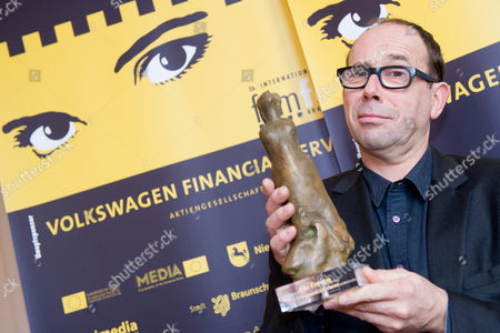 Belgian Actor Olivier Gourmet Poses with the European Actor 'The Europa' Award During the 26th Braunschweig International Film Festival at the State Theatre in Braunschweig Germany 11 November 2012 the Main Prize is Endowed with 10 000 Euros Germany Braunschweig