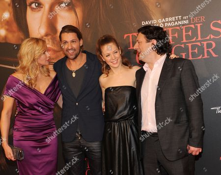 Stock Photo of (l-r) German Actors/cast Members Veronica Ferres David Garrett Andrea Deck and British Director Bernard Rose Arrive on the Red Carpet For the World Premiere of the Movie 'The Devil's Violinist' at the Mathaeser Movie Palace in Munich Bavaria Germany 24 October 2013 the Movie Willbe Released in German Theatres on 31 October Germany Munich