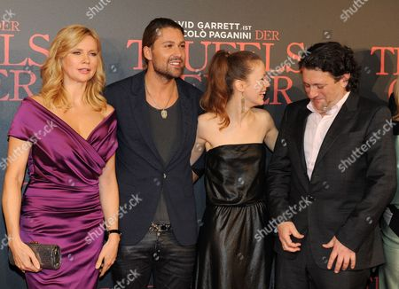 Stock Picture of (l-r) German Actors/cast Members Veronica Ferres David Garrett Andrea Deck and British Director Bernard Rose Arrive on the Red Carpet For the World Premiere of the Movie 'The Devil's Violinist' at the Mathaeser Movie Palace in Munich Bavaria Germany 24 October 2013 the Movie Willbe Released in German Theatres on 31 October Germany Munich