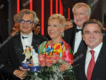 From L-r German Film Directors Wim Wenders Doris Doerrie Bavarian State Premier Horst Seehofer and German Actor Elmar Wepper Pose For Photos at the the Bavarian Film Prize 2011 Event in Munich Germany Late 20 January 2012 the Film Prize is One of the Most Prestigious Ones in German Cinema Industry Germany Munich