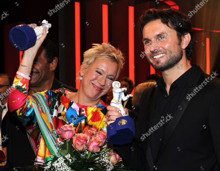 From L-r German Film Directors Doris Doerrie and Simon Verhoeven Pose For Photos at the the Bavarian Film Prize 2011 Event in Munich Germany Late 20 January 2012 the Bavarian Film Prize is One of the Most Prestigious Ones in German Cinema Industry Germany Munich