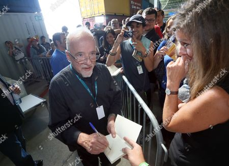 Brazilian Author Paulo Coelho Signs Autographs After His Talk at the Campus Party Europe in Berlin Germany 22 August 2012 Coelho Called For the Publishing Sector to Accept the Changes Caused by the Internet and to Move Away From a Rigid Copyright Mentality at the Technology Festival Germany Berlin