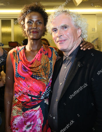 Waris Dirie (l) Somalian Author and Activist Against Female Genital Mutilation and British Conductor Sir Simon Rattle Attend the Opening of the Desert Flower Medical Centre of Which Dirie is a Patron at Hospital Waldfriede in Berlin Germany 11 September 2013 the Centre is the First Hospital in Europe That Treats Women with Female Gentical Cutting Psychologically and Surgically Germany Berlin