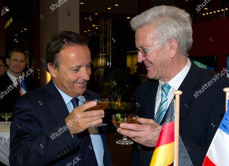 Germany Federal Minister and Minister President of Baden-wuerttemberg Winfried Kretschmann (r) and the President of the French Senate Jean-pierre Bel (l) Toast During the Evening Reception of the Franco- German Agreement Anniversary Celebrations in Berlin Germany 22 January 2013 They Are Meeting For the 50th Anniversary Celebrations of the Signing of the Elysee Treaty of 22 January 1963 Germany Berlin
