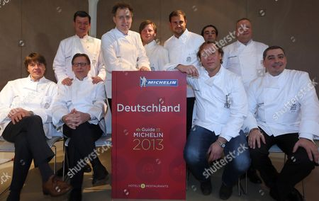 Stock Photo of The Ten German Three-star Chefs Joachim Wissler (l-r) (vendome in Bergisch-gladbach) Helmut Thieltges (waldhotel Sonnora in Wittlich) Harald Wohlfahrt (schwarzwaldstube in Baiersbronn) Sven Elverfeld (aqua in Wolfsburg) Kevin Fehling (la Belle Epoque in Luebeck-travemuende) Klaus Erfort (gaeste Haus Klaus Erfort in Saarbruecken) Juan Amador (amador in Mannheim) Thomas Buehner (la Vie in Osnabrueck) Claus-peter Lumpp (restaurant Bareiss in Baiersbronn) and Christian Bau (victor's Gourmet Restaurant Schloss Berg in Perl) Pose For a Group Picture on the Occasion of the Announcement of the New Michelin Stars in Berlin Germany 07 November 2012 Restaurant Guide 'Michelin' Awarded the Tenth Restaurant in Germany with Three Stars Right on Time For the Guide's 50th Anniversary Germany Berlin