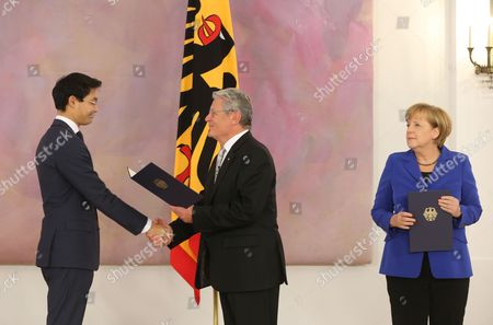 German President Joachim Gauck (c) Hands Finance Minister Philipp Roesler (l)áhis Certificate of Discharge Next to Germanáchancellor Angela Merkel (r)áat Bellevue Palace in Berlin Germany 22 October 2013 the Current German Government Will Remain in Charge Until a New Coalition is Formed Germany Berlin