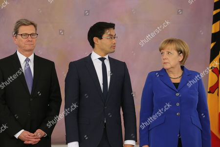 Germanáchancellor Angela Merkel (r-l) Economics Minister Philipp Roesler Andáforeign Minister Guido Westerwelle Stand During the Ceremony to Issue Certificates of Discharge at Bellevue Palace in Berlin Germany 22 October 2013 the Current German Government Will Remain in Charge Until a New Coalition is Formed Germany Berlin