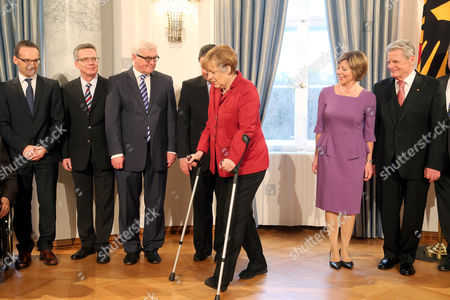 German President Joachim Gauck (r) and His Partner Daniela Schadt (2-r) Greet Government Ministers As German Chancellor Angela Merkel (c) Walks on Crutches Following a Skiing Accident During the New Year Reception in Berlin Germany 09 January 2013 German Justice Minister Heiko Maas Interior Minister Thomas De Maiziere Foreign Minister Frank-walterásteinmeier and Economics Minister Sigmar Gabriel Stand Behind Her Traditionally the Head of State Greets Tops of Political Economy Culture and Public Life Personalities As Part of New Year Wishes Germany Berlin