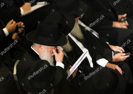 A Participant of the Conference of European Rabbis Rubs His Eyes During a Memorial Service Commemorating the 75th Anniversary of Kristallnacht in the Beth Zion Synagogue in Berlin Germany 10 November 2013 the Kristallnacht Also Known As 'Night of Broken Glass' 'Pogromnacht' Or 'Reichskristallnacht' was a Series of Coordinated Attacks Against Jews in Nazi Germany in the Night of 09 to 10 November 1938 After an Anti-semitic Rabble-rousing Speech by Nazi Propaganda Minister Joseph Goebbels Assault Troops of the Ss and Sa the Paramilitary Organizations of Hitler's Ruling Nsdap on 09 and 10 November 1938 Burnt Down 267 Synagogs Destroyed the Windows of 7 500 Jewish Shops Vandalized Jewish Cemeteries and Battered People Splintered Windows and Glass Splinters on the Streets Gave the Inspiration For the Downplaying Labelling of the Pogrom As 'Night of the Broken Glass' 91 People Died 20 000 Were Detained Germany Berlin