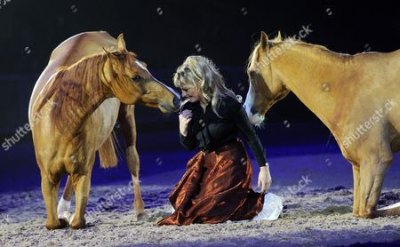 Stock Picture of Dressage Rider Sylvie Willms Performs with Two Horses During the Horse Show 'Cavallo Classico' in Munich Germany 27 December 2013 the Show Runs Until 31 December in Munich Germany Munich