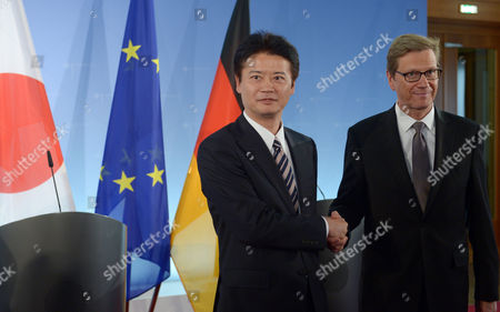 German Foreign Minister Guido Westerwelle (r) and His Japanese Counterpart Koichiro Gemba Shake Hands After a Press Conference at the Foreign Office in Berlin Germany 19 October 2012 Germany Berlin