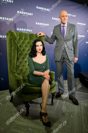 Stock Image of British Andrew Jennings Ceo of the Warehouse Chain Karstadt and Us Burlesque Model Dita Von Teese Pose For the Camera Within a Newly Renovated Karstadt Shop in Duesseldorf Germany 04 September 2013 Germany Duesseldorf