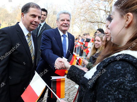 German President Joachim Gauck (c) and Maltese President George Abela (l) Welcome Pupils at Bellevue Palace in Berlin Germany 11 March 2014 Germany Berlin