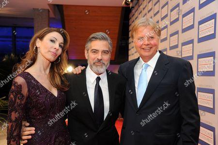 The Laureate of the German Media Prize 2012 Us Actor George Clooney (c) Arrives with the Award's Sponsor Karlheinz Koegel (r) of Media Control and His Wife Dagmar Koegel (l) For the Awards Ceremony at the Conference Center of Baden-baden Germany 26 February 2013 Germany Baden-baden
