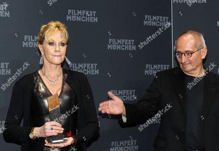 Us Actress Melanie Griffith (l) Holds Her Cinemerit Award Next to Her Laudator German Filmmaker Dominik Graf (r) During the Munich Film Festival in Munich Germany 03 July 2012 the Award is Presented Annually by the Munich Film Festival Since 1997 the Festival Runs Until 07 July Germany Munich