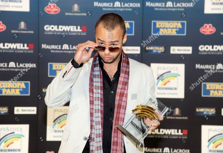British Musician Marlon Roudette Poses with the Award in the Category 'Song of the Year 2011' During the Radio Regenbogen Award Ceremony in Karlsruhe Germany 30 March 2012 Germany Karlsruhe