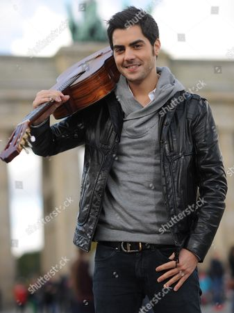 Stock Picture of Montenegrin Classical Guitarist Milos Karadaglic Poses For the Camera at the Brandenburg Gate in Berlin Germany 14 October 2012 the Musician is One of the Awardees of the Echo Klassik Music Award Which is Awarded on the Same Day Germany Berlin