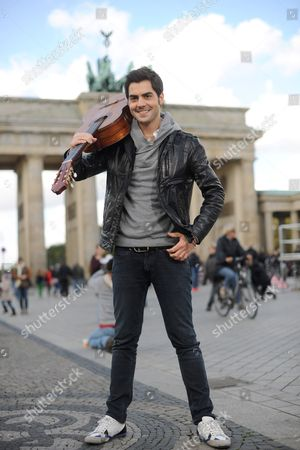 Stock Image of Montenegrin Classical Guitarist Milos Karadaglic Poses For the Camera at the Brandenburg Gate in Berlin Germany 14 October 2012 the Musician is One of the Awardees of the Echo Klassik Music Award Which is Awarded on the Same Day Germany Berlin