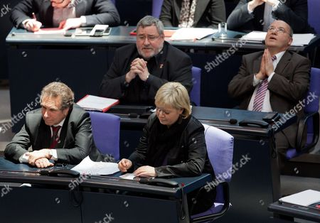 Left Party Leaders Klaus Ernst (frontrow L-r) and Gesine Loetzsch and Members of the German Bundestag Fraction of the Left Party Axel Troost (backrow L-r) and Gregor Gysi Follow the Speech by German Minister of the Interior Friedrich During a Question Time on the Surveillance of Members of the Left Party by the Office For the Protection of the Constitution at the Bundetag in Berlin Germany 26 January 2012 Germany Berlin