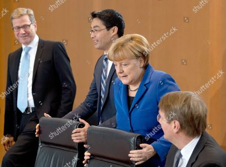 Chief of Staff Ronald Pofalla (r-l) German Chancellor Angela Merkel German Economy Minister Philipp Roesler and German Foreign Minister Guido Westerwelle Before the Start of a Cabinet Meeting in Berlin ágermany 20 November 2013 Germany Berlin