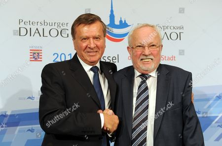 The Two Co-chairman of the Petersburg Dialogue Wiktor Subkow (l) and Lothar De Maiziere Shakes Hands During a Press Conference in Kassel Germany 04 December 2013 the 13th Petersburg Dialogue Discussion Forum Focussed on Russian-german Relationships Germany Kassel