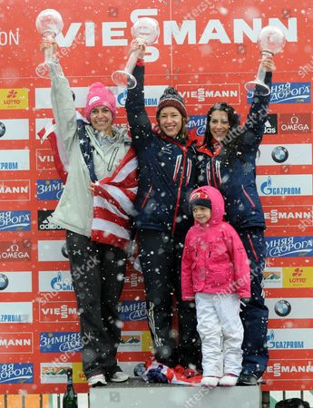 Skeleton Drivers Usa's Noelle Pikus-pace (l-r) British Elizabeth Yarnold and Shelley Rudman with Her Daughter Ella Hold Their Trophies After the Skeleton World Cup at Koenigssee Near Berchtesgaden Germany 24 January 2014 Yarnold Came in First Overal Pikus-pace Second and Rudman Third Germany Koenigssee