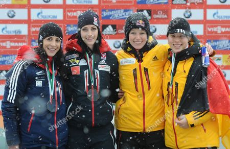 Skeleton Drivers Britain's Shelley Rudman (l-r) Austria's Janine Flock Andágermany's Anja Huber and Sophia Griebel Stand During the Medal Ceremony of the Skeleton World Cup at Koenigssee Near Berchtesgaden Germany 24 January 2014 Flock is European Champion Rudman Came in Second and Huber and Griebel Share Third Germany Koenigssee