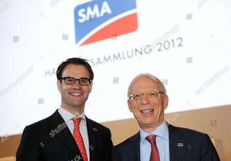 Stock Image of Sma Solar Chairman of the Board Pierre-pascal Urbon (l) and Chairman of the Supervisory Board Guenther Cramer Pose For the Cameras Prior to the Annual General Meeting of the German Solar Energy Equipment Supplier Sms Solar in Kassel Germany 22 May 2012 Sma Solar Achieved Its Second-best Result in the Company's History in 2011 Germany Kassel