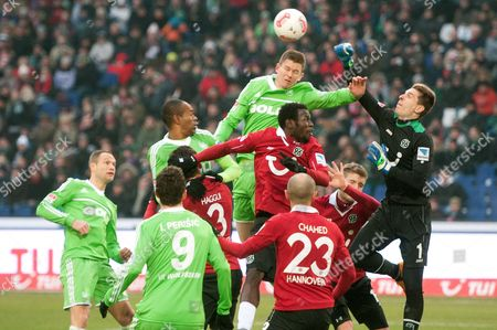 Wolfsburg's Alexander Madlung (c) Vies with the Ball with Hannover's Johan Djourou (c-bottom) and Goal Keeper Ron-robert Zieler (r) During the Bundesliga Soccer Match Between Hannobver 96 and Vfl Wolfsburg at Awd Arena in Hanover Germany 26 January 2013 (attention: Embargo Conditions! the Dfl Permits the Further Utilisation of Up to 15 Pictures Only (no Sequntial Pictures Or Video-similar Series of Pictures Allowed) Via the Internet and Online Media During the Match (including Halftime) Taken From Inside the Stadium And/or Prior to the Start of the Match the Dfl Permits the Unrestricted Transmission of Digitised Recordings During the Match Exclusively For Internal Editorial Processing Only (e G Via Picture Picture Databases) Germany Berlin