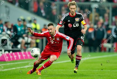Munich's Diego Contento (l) Vies For the Ball with Leverkusen's Simon Rolfes During the German Bundesliga Soccer Match Between Fc Bayern Munich and Bayer 04 Leverkusen at the Allianz Arena in Munich Germany 15 March 2014 (attention: Due to the Accreditation Guidelines the Dfl Only Permits the Publication and Utilisation of Up to 15 Pictures Per Match on the Internet and in Online Media During the Match ) Germany Munich